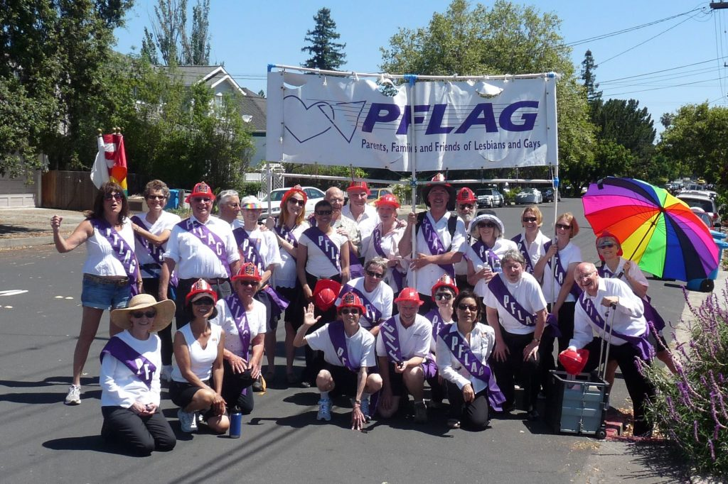 PFLAG Organization marching together in the Pride parade