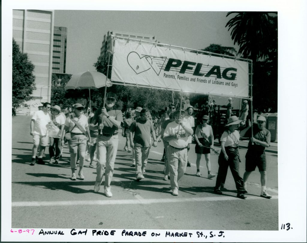 PFLAG Organization marching together in the Pride parade, 1997