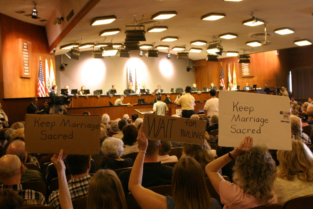 """Opponents of Item 3.5 hold signs saying """"Keep Marriage Sacred."""""""